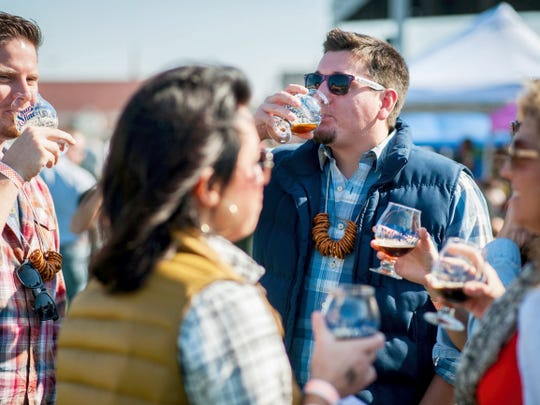 Andrew Shive, left, and Andrew Vriens, center, sample beers at Yorktoberfest last year along with Dana Shive, foreground left, Kellye Ness, and Niki Kalemnous. The fifth annual event, which was moved to the York Fairgrounds last year, will be held Oct. 10-11.