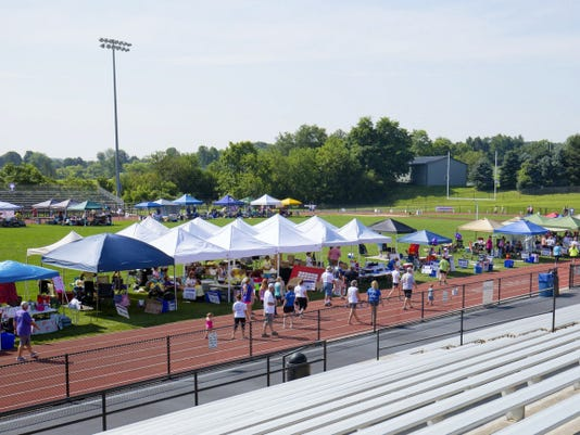 Tents line the track at the South Western High School football stadium as participants walk laps during the 2015 Hanover Relay For Life on Saturday.