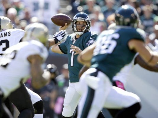 Philadelphia's Sam Bradford passes during the first half of Sunday's game against the New Orleans Saints in Philadelphia. Bradford overcame two red-zone interceptions and threw for 333 yards and two touchdowns in the Eagles' 39-17 victory.