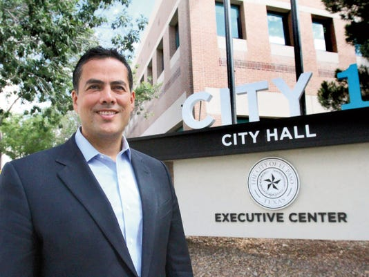 Incoming El Paso City Manager Tommy Gonzalez walks outside CITY 1 building at 300 N. Campbell on his way to CITY 2 across Mills St., during a visit on Thursday. Gonzalez will officially begin his job as city manager on Monday.
