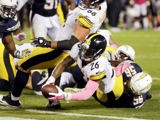 Pittsburgh Steelers running back Le'Veon Bell scores a touchdown in the final seconds of Monday's game against the Chargers, giving the Steelers a 24-20 victory in San Diego.