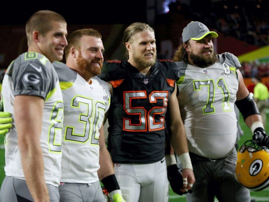 John Kuhn, second from left, is seen here with his Green Bay teammates, Jordy Nelson, left, Clay Matthews, second from right and  Josh Sitton after last Sunday's Pro Bowl.