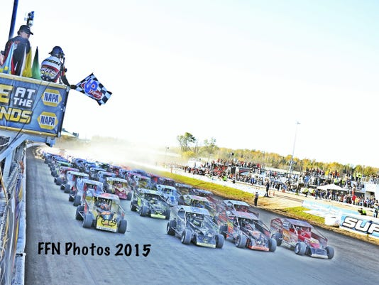 The drivers do a four-wide salute to the fans at the Syracuse 200, which was the last dirt race held at the Moody Mile.
