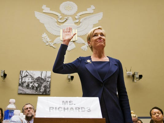 """In this Tuesday, Sept. 29, 2015 photo, Planned Parenthood Federation of America President Cecile Richards is sworn in before testifying at a House Committee on Oversight and Government Reform Hearing on """"Planned Parenthood's Taxpayer Funding,"""" in Washington. Responding to a furor over undercover videos, Planned Parenthood said Tuesday, Oct. 13, 2015 it will maintain programs at some of its clinics that make fetal tissue available for research, but will no longer accept any sort of payment to cover the costs of those programs. (AP Photo/Jacquelyn Martin)"""