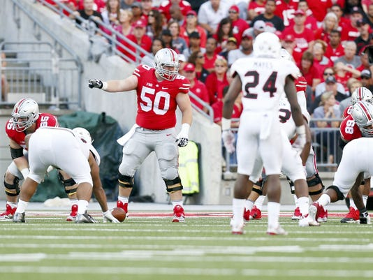 Ohio State center Jacoby Boren, No. 50, credits his two older brothers — both former Buckeye football players — with breaking him down before building him up when he was a kid. Now, Jacoby is a standout lineman, the team's top student and primed to help lead the family business.