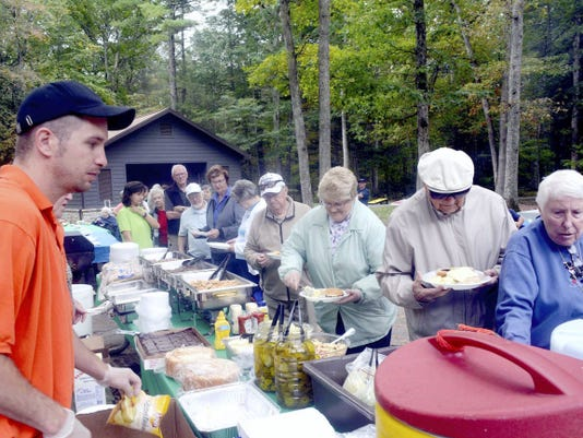Residents of three SpiriTrust Lutheran senior living communities are served a lunch of hamburgers, hot dogs and grilled chicken at Caledonia State Park.