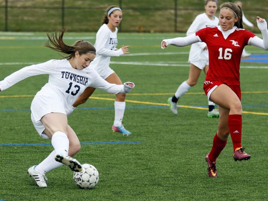 Manheim Township's Emily Amspacher tries to fake out Annville-Cleona's Sarah Fisher.