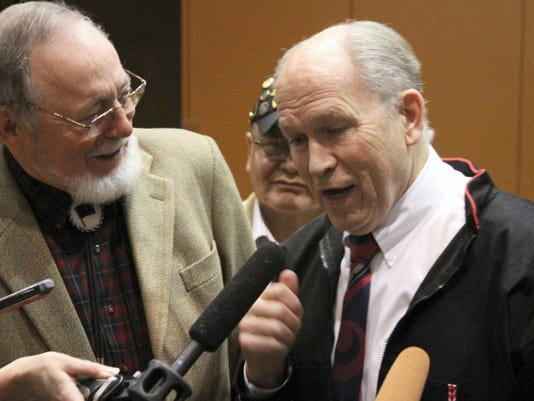 U.S. Rep. Don Young, R-Alaska,, left, listens as Alaska Gov. Bill Walker speaks to reporters at the Alaska Federation of Natives conference in Anchorage, Alaska, on Friday, Oct. 16, 2015. The men spoke after Interior Secretary Sally Jewell said her agency was canceling future lease sales and will not extend current drilling leases in Arctic waters off Alaska's northern coast. (AP Photo/Mark Thiessen)