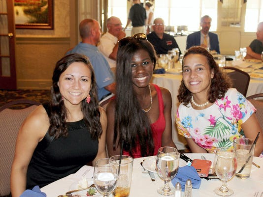 Lebanon Valley College students, from left, Mary Baldassare, Zania Walker and Cristalichia Acevedo pose at the annual Achievement Challenge Golf Tournament and dinner in September. Funds raised at the tournament benefit the Lebanon Valley Education Partnership scholarships.
