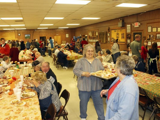 Over 1,000 guests enjoyed the Metcalfe family's Thanksgiving dinner in 2014 at the Lemasters Community Center. Planning is nearing the end this year, and organizers request those planning to attend or get a to-go meal make reservations now.