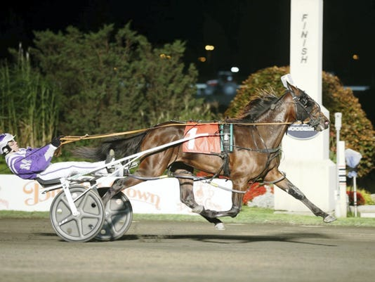 Born in Wellsville, Pure Country is favored to win the 600,000 Breeders Crown in Toronto Saturday. Pure Country is pictured above winning the first of two 20,000 Breeders Crown elimination races at Woodbine Friday.