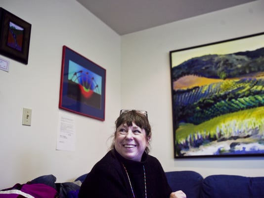 NEWS THE EVENING SUN -- SHANE DUNLAP Adams County artist Andrea Theisson talks about artwork in this file photo from 2013.