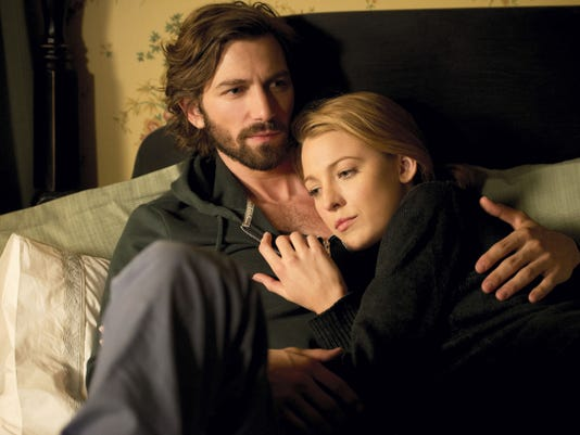 "This image released by Lionsgate shows Michiel Huisman, left, and Blake Lively in a scene from ""The Age of Adaline."""