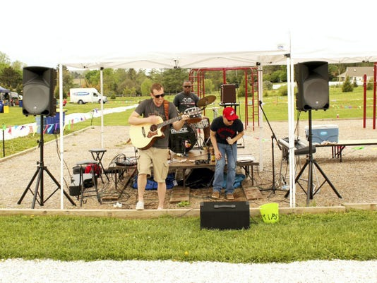 The AKT will play live music for this year's Sip Into Summer festival at St. Rose of Lima.