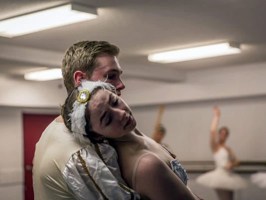 "Jenny Milania as Odette the white swan and Thomas Anthony as Prince Siegfried rehearse a scene in ""Swan Lake, performed May 17 by City Ballet School in The Maryland Theatre, Hagerstown, Md. Milani also dances the role of Odile the black swan."