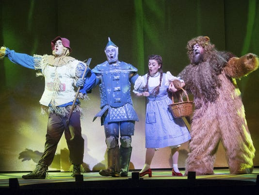 """Will Ray as the Tin Man, Liz Shivener as Dorothy, Jason Simon as the Cowardly Lion and Tim Hughes as the Scarecrow are shown in a scene from the Fulton Theatre's  """"The Wizard of Oz."""""""
