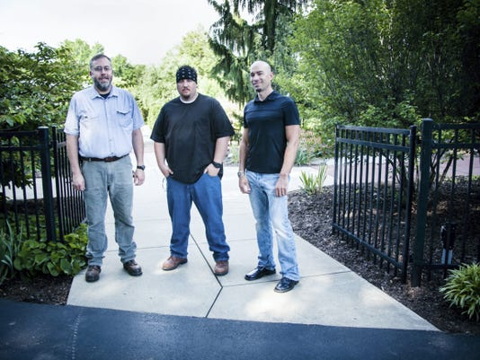 Four local artists have contributed their nature-themed work to Hershey Gardens for the 2015 summer art exhibit. Shane Morgan (right) and Eli Weaber (center) of Lebanon, Pa., Scott Farmer of Palmyra, Pa. (left), and Jason Lyons of Harrisburg, Pa (not pictured).
