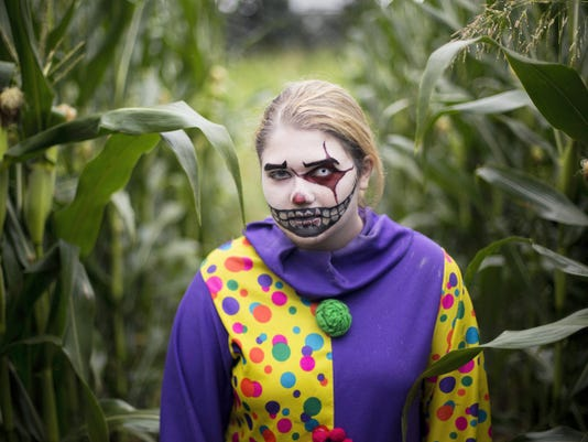 Hope Messersmith plays an insane clown at Field of Screams in Mountville, Lancaster County.