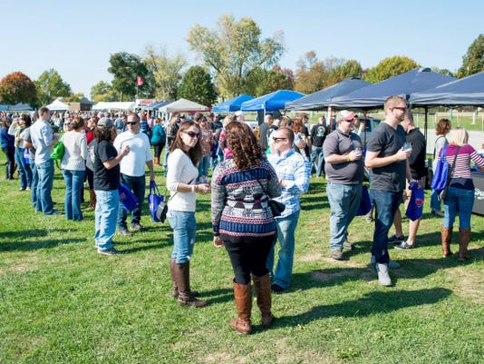 People browse through food and beverage tents during last year's Yorktoberfest at the York Fairgrounds infield. This year's event will be held Oct. 10-11.