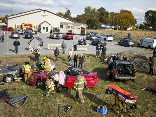 Members of New Bridgeville Memorial Fire Company, Airville Volunteer Fire Company, and Southern York County Emergency Medical Services demonstrate how to extract people who are trapped in a vehicle.