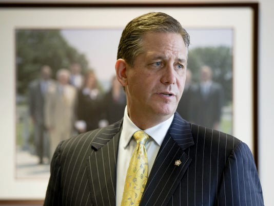 FILE - In this file photo taken July 7, 2015, a member of the Montgomery County, Pa., board of commissioners and former district attorney of the county, Bruce L. Castor Jr., speaks during an interview with The Associated Press in Norristown, Pa. Castor is campaigning to become the county's district attorney again as the Republican nominee, but Democratic challenger Kevin Steele introduced a 30-second ad on Tuesday, Oct. 20, 2015, to remind voters that Castor declined to bring charges against entertainer Bill Cosby in 2005, after a former Temple University employee alleged Cosby drugged and sexually assaulted her. (AP Photo/Matt Rourke, File)