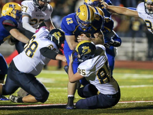 Waynesboro's Aiden Smith (42) bulls into the end zone for a touchdown against Greencastle-Antrim's Zachary Koons (85) on Friday night. Smith scored a pair of touchdowns, and the Indians won, 53-19.