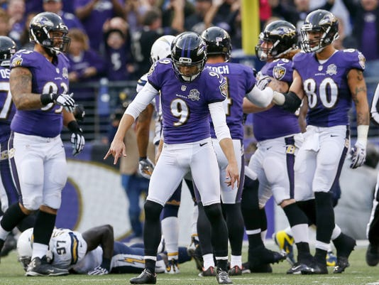 Baltimore Ravens kicker Justin Tucker (9) celebrates his game winning field goal during the second half of Sunday's game against the San Diego Chargers in Baltimore. The Ravens defeated the Chargers, 29-26.