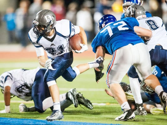 Dallastown's Addison Quinones (21) breaks through the Spring Grove defensive line during a YAIAA football game Sept. 19. Quinones rushed for 139 yards on 19 carries. Dallastown won, 20-3.