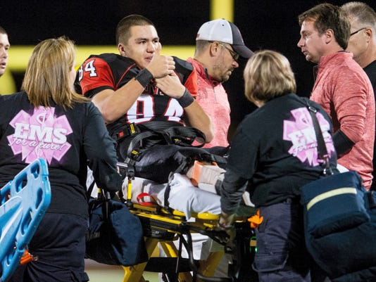 Dover's Derek Breneman gives a thumbs up sign as he is carted off the field on a stretcher to an ambulance last October after a leg injury on a punt return against York Suburban. Breneman said shortly after the injury he wanted to return from the broken fibula and ankle. This week marked the first week of high school football practices, and Breneman is back.