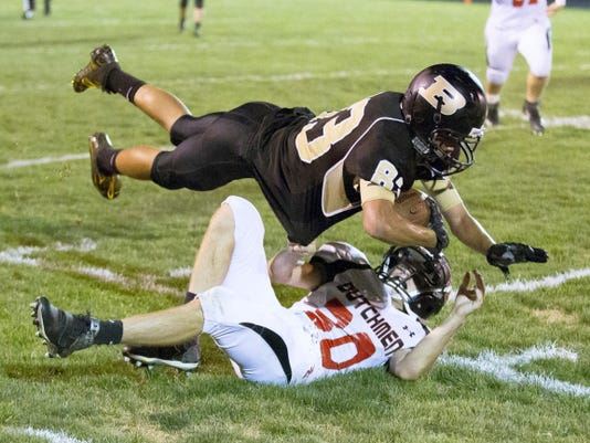 Biglerville's Gage McAuliffe is tackled by Annville-Cleona's Kurtis Reigle during Friday's game.