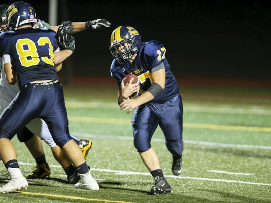 James Hines (17) runs the ball for Greencastle-Antrim as Brae Peck (83) lays a block against West Perry on Friday. Hines finished the game with 89 of the Blue Devils' 323 rushing yards.