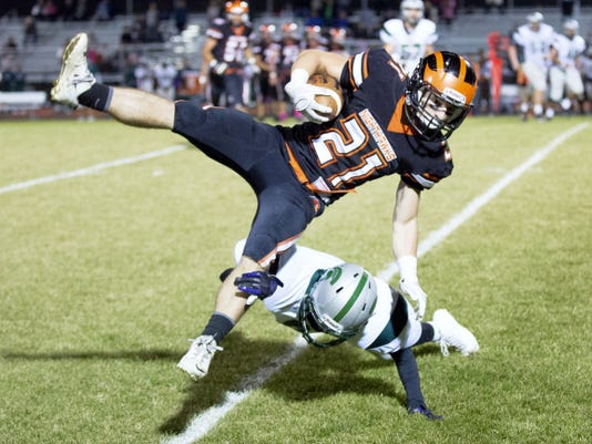 Hanover's Nick Seymour is tackled by York Tech's David Porter during a game against the York Tech Spartans at Hanover's Sheppard & Myers Stadium on October 23rd, 2015.