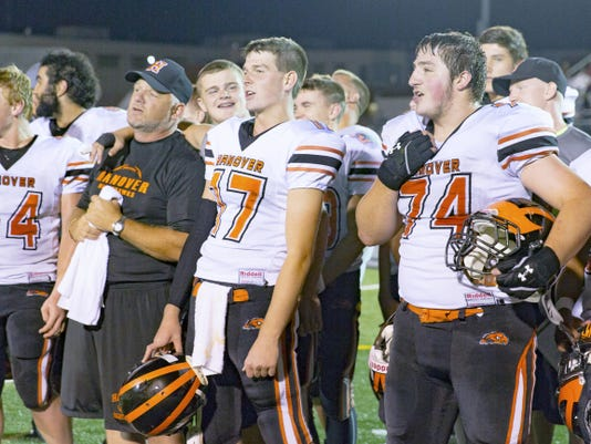 Just before exiting the field at Bermudian Springs High School on Sept. 25, the Hanover Nighthawks gather to sing their alma mater alongside their coach, Bill Reichart. This victory marked their fourth consecutive victory of the season.