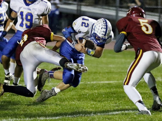 Northern Lebanon's Isaac Wengert pushes forward and breaks the goal line for a touchdown during the Vikings' Section Three-clinching 53-14 win at Columbia on Friday night.
