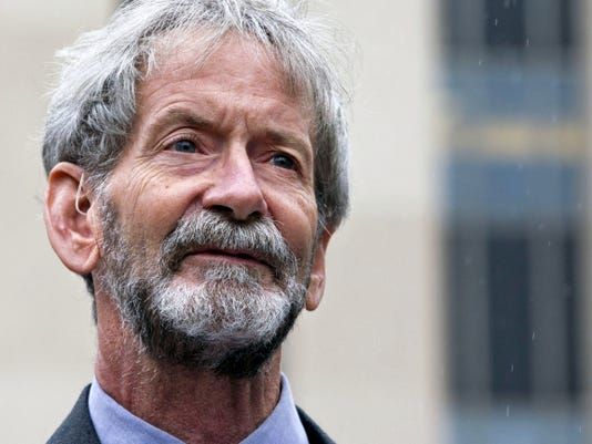 FILE - In this May 21, 2015 file photo, Douglas Hughes of Florida speaks to reporters outside federal court in Washington. Hughes, who flew a gyrocopter through some of America's most restricted airspace before landing outside the U.S. Capitol earlier this year, will plead guilty in connection with the incident, his lawyer says on Nov. 5. Hughes is expected to plead guilty to operating a gyrocopter without a license, a felony, on Nov. 20.  (AP Photo/Jacquelyn Martin, File)