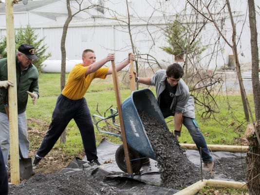 Andrew Durfee lays rock Saturday as part of an Eagle Scout project to create a 621-foot horseshoe-shaped walking trail of service at the Franklin County Veterans and 9/11 Memorial Park.