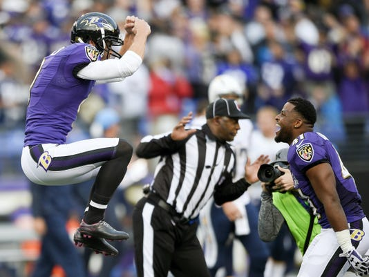 Baltimore Ravens kicker Justin Tucker, left,  celebrates his game winning field goal with teammate cornerback Anthony Levine during the second half of a Nov. 1 game against the San Diego Chargers in Baltimore. The Ravens, at 2-6, are on track for their first losing season since 2007.