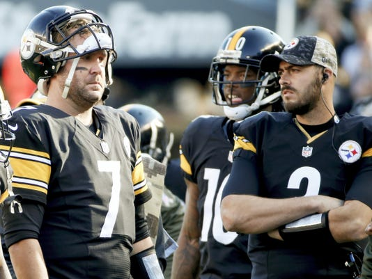 Pittsburgh quarterback Ben Roethlisberger, left, stands with Landry Jones, right, during Sunday's game vs. Oakland. Jones will replace the injured Roethlisberger as the Steelers' starting QB this Sunday vs. Cleveland.