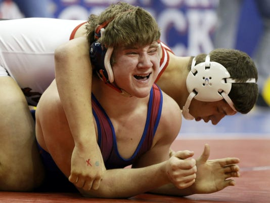 Selinsgrove's Andrew Boob, center, struggles against South Western's Seth Janney during their 220-pound quarterfinal Friday at the PIAA Class AAA wrestling championships in Hershey.
