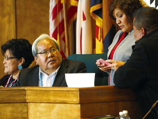 Navajo Nation Council Speaker Johnny Naize talks with council staffers prior to the start of the winter session of the Navajo Nation Council on Monday at the Council Chambers in Window Rock, Ariz.