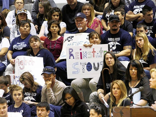 Wrestlers, parents and students listen as supporters speak on behalf of Piedra Vista High School's former wrestling coach Levi Stout on Thursday during the Farmington Municipal School District's Board of Education meeting at the Jerry A. Conner Fieldhouse in Farmington.