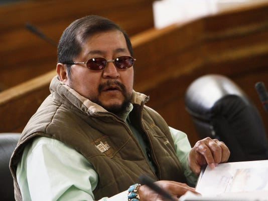 Navajo Nation Council Delegate David Tom sits at his desk on Jan. 27 before the start of the winter session of the tribal council at the Council Chambers in Window Rock, Ariz.