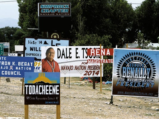 Campaign signs are posted on July 28 near the Shiprock Chapter house. Seventeen candidates are running for the tribal presidency this year.