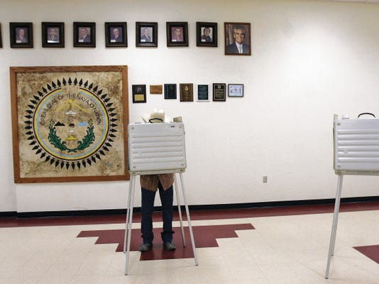 Ray Balone fills in his ballot in the Navajo Nation primary election on Tuesday at Nenahnezad Chapter House in Upper Fruitland.