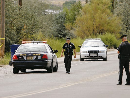 New Mexico State Police investigate the shooting of John Rogers on Aug. 27 at his home on Ruth Lane in Bloomfield.