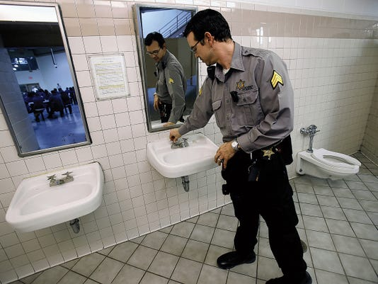 San Juan County Adult Detention Center Sgt. Cockrell shuts off a faucet Thursday inside the women's C5 pod at the San Juan County Adult Detention Center in Farmington. Facility officials declined to provide the first names of jail personnel.