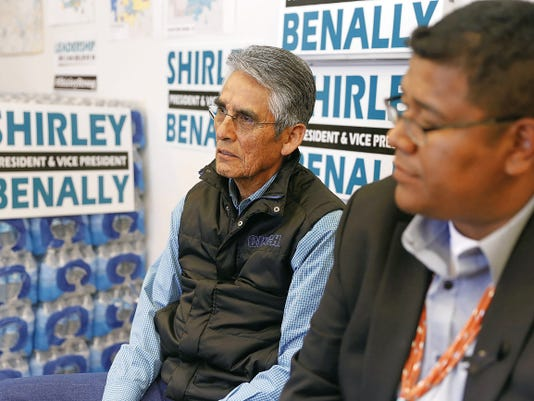 Navajo Nation presidential candidate Joe Shirley Jr., left, and vice presidential candidate Dineh Benally listen to questions April 13 during an interview at their headquarters in Window Rock, Ariz.