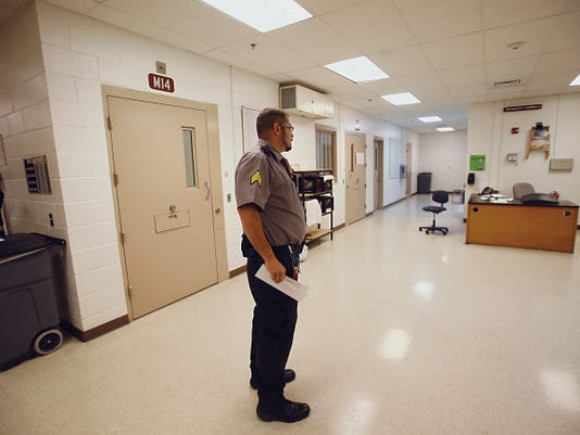 An employee of the San Juan County Adult Detention Center checks the medical unit at the detention center in Farmington on Friday. Employees did not provide their full names because of security concerns.