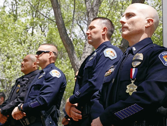 Members of the local law enforcement community listen Friday during the San Juan County Law Enforcement Memorial ceremony at the All Veterans Memorial Plaza at Berg Park in Farmington.