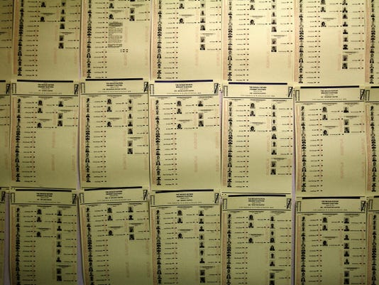 Sample ballots are posted on Monday on a wall at the Navajo Election Administration — Northern Agency Office in Shiprock.